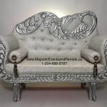 Picture of a Loveseat with a Peacock engraved on it's backavailable for rent